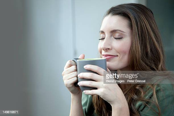 Caucasian woman drinking coffee