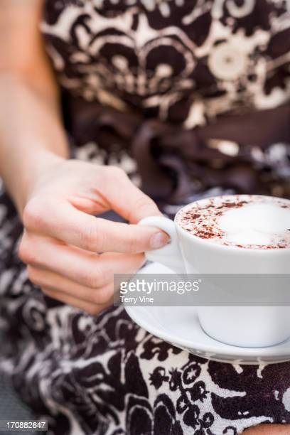 Caucasian woman drinking cup of coffee