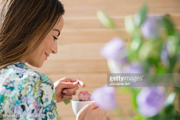 caucasian woman drinking cup of tea - steeping stock pictures, royalty-free photos & images