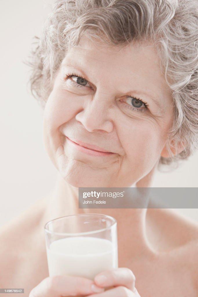 Caucasian woman drinking milk : Foto de stock