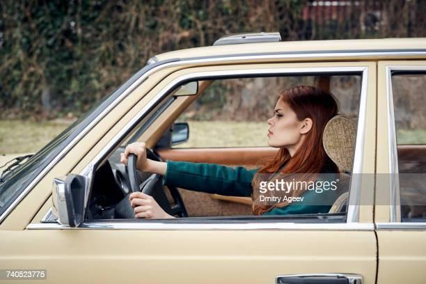Caucasian woman driving car