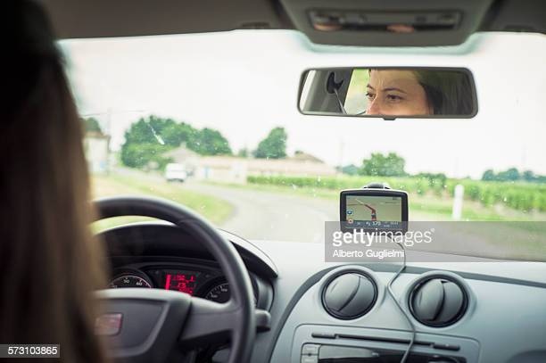 Caucasian woman driving car with GPS navigation