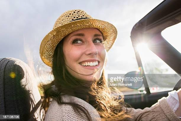 Caucasian woman driving convertible