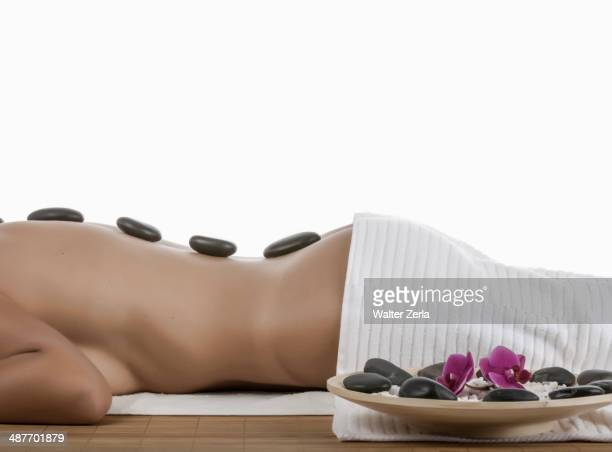 caucasian woman enjoying hot stone massage - images of massage rooms stock-fotos und bilder