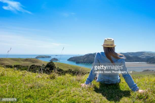 Caucasian woman enjoying scenic view of ocean