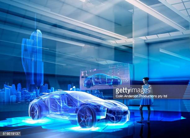 caucasian woman examining hologram of car - hologram stock pictures, royalty-free photos & images