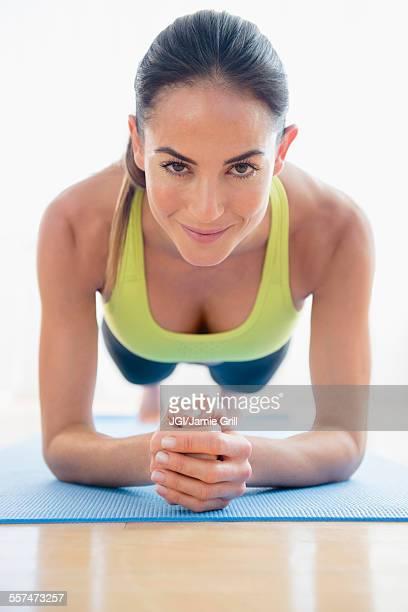 Caucasian woman exercising on yoga mat