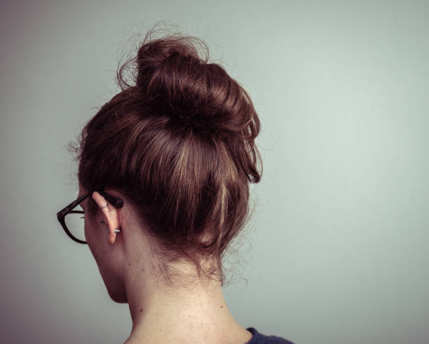Caucasian Woman From Behind With Brown Hair In A Ponytail