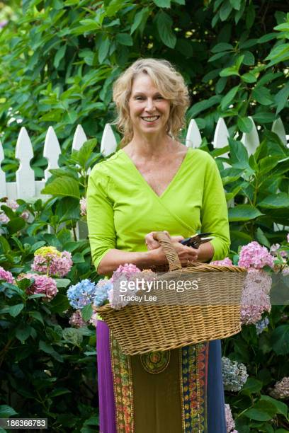 Caucasian woman gathering flowers