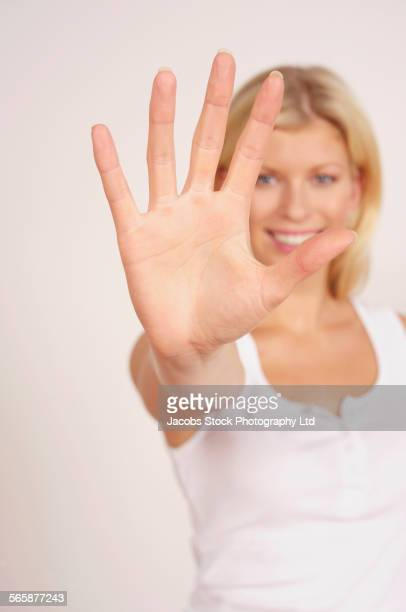 Caucasian woman gesturing to stop