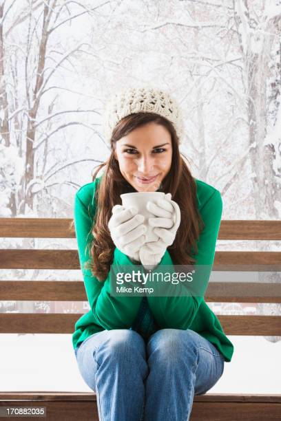 caucasian woman having cup of coffee in snow - tea hot drink stock pictures, royalty-free photos & images