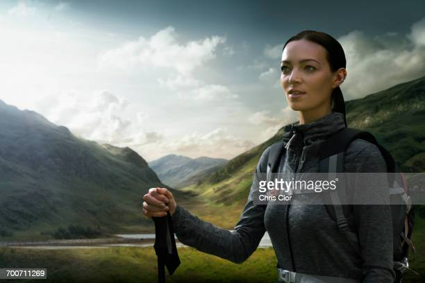 Caucasian woman hiking in green valley