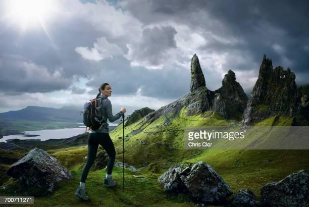 Caucasian woman hiking in rocky landscape