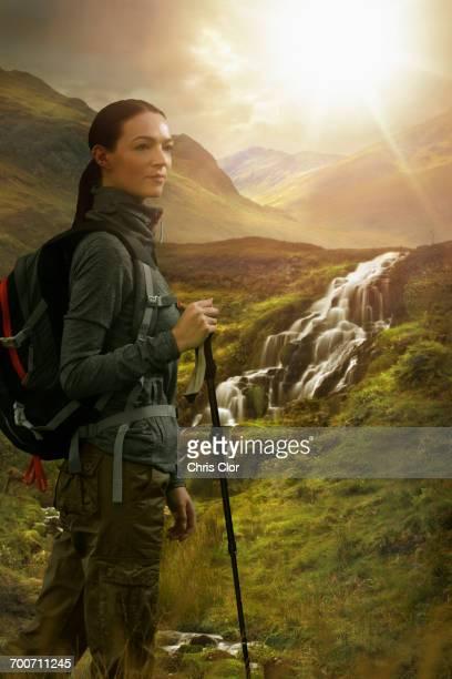 Caucasian woman hiking near waterfall