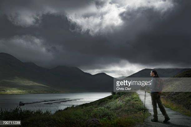 Caucasian woman hiking on path near river