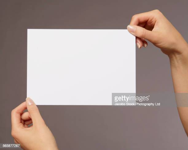 Caucasian woman holding blank card