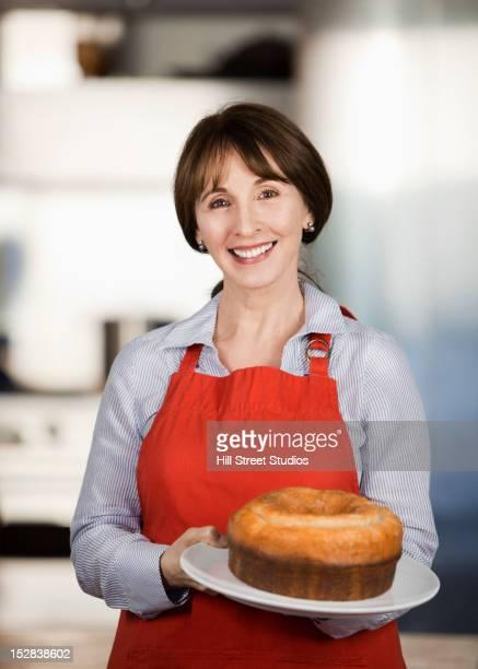 Caucasian woman holding cake
