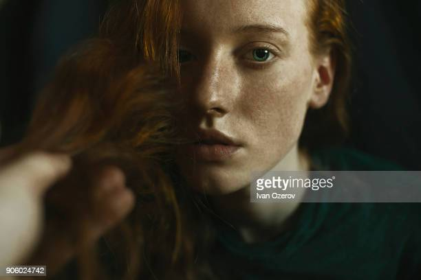 caucasian woman holding hair - freckle stock photos and pictures