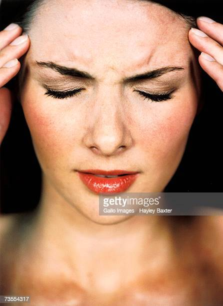 Caucasian Woman Holding Her Head in Pain