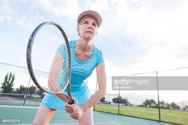 Caucasian woman holding tennis racket