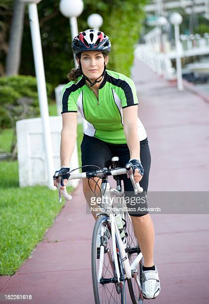 Caucasian Woman in Forties Riding Racing Bicycle.