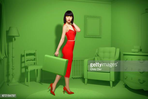 Caucasian woman in green old-fashioned bedroom carrying suitcase