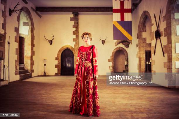 Caucasian woman in medieval costume standing in castle