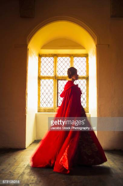 Caucasian woman in medieval costume walking in castle