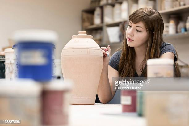 Caucasian woman in pottery workshop
