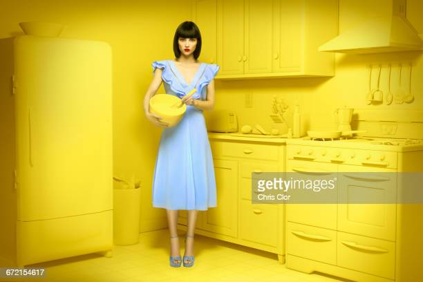caucasian woman in yellow old-fashioned kitchen holding mixing bowl - purple dress stock pictures, royalty-free photos & images