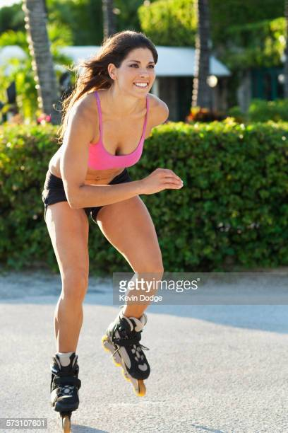 Caucasian woman inline skating in park