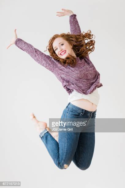 Caucasian woman jumping for joy