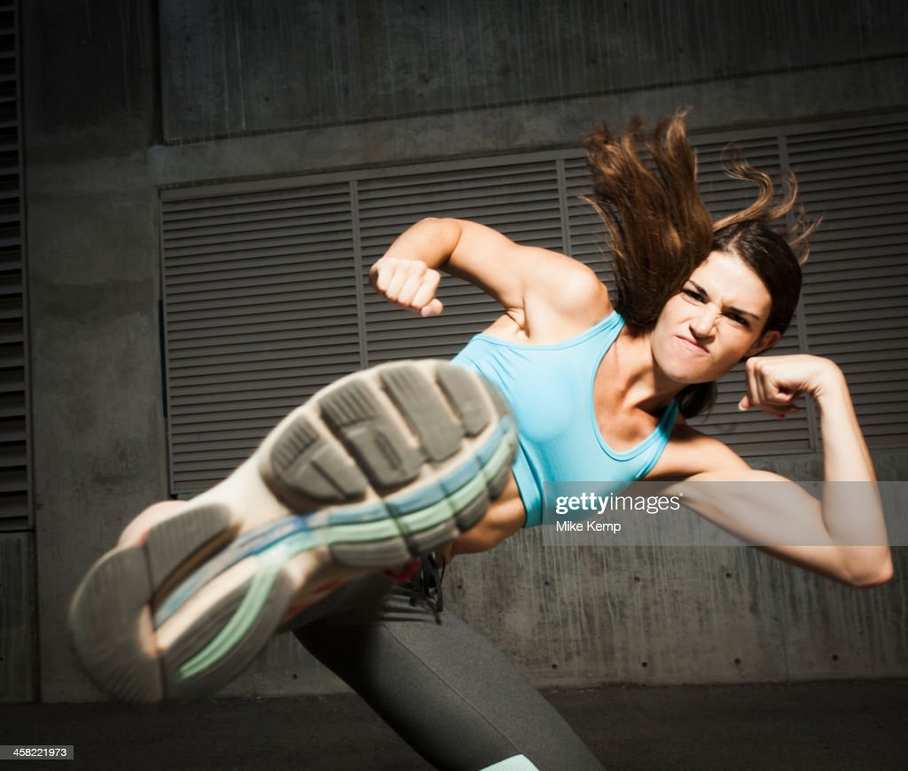 Caucasian woman kicking : Stock Photo
