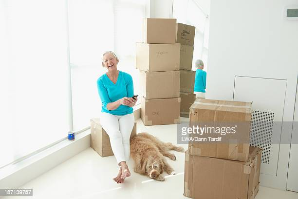Caucasian woman laughing in new home
