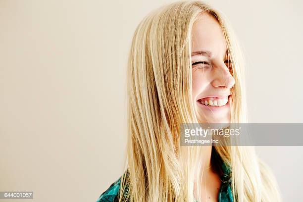 caucasian woman laughing - squinting stock photos and pictures