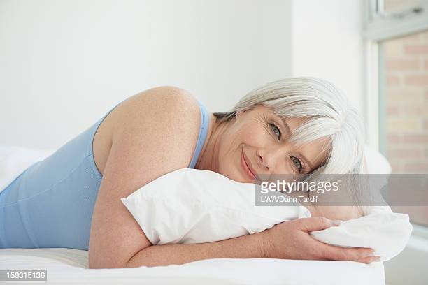 Caucasian woman laying in bed
