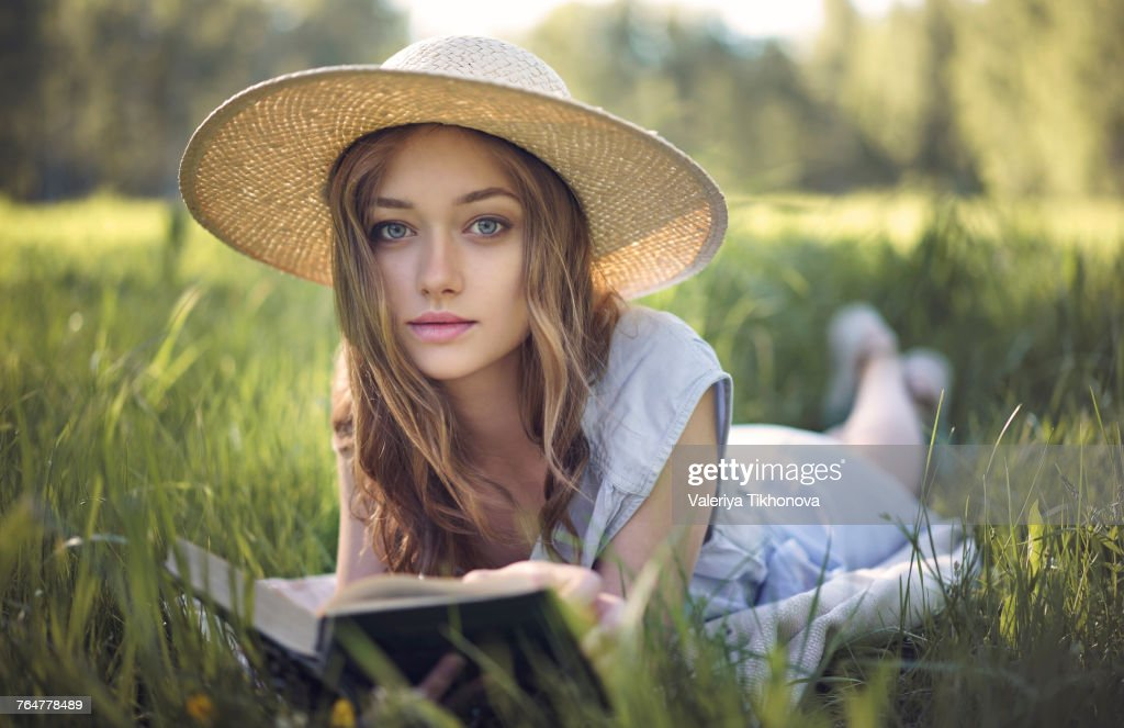 Woman Lying in Grass stock photo. Image of hair, pretty