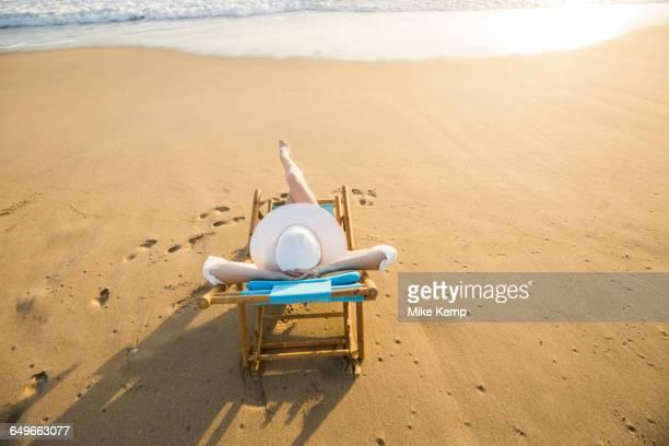 Caucasian woman laying on beach