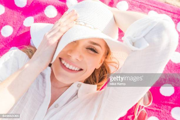 Caucasian woman laying on towel