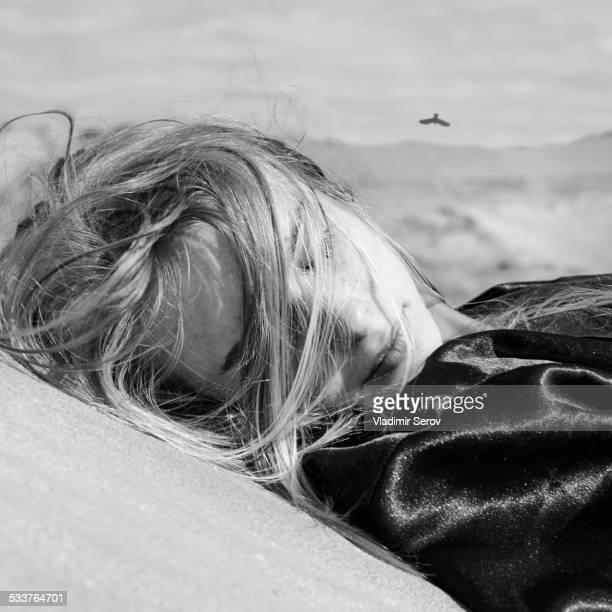 Caucasian woman laying outdoors