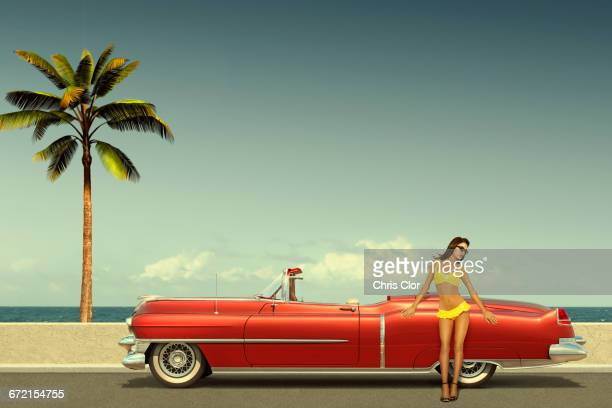 caucasian woman leaning on old-fashioned convertible car at ocean - pin up vintage photos et images de collection