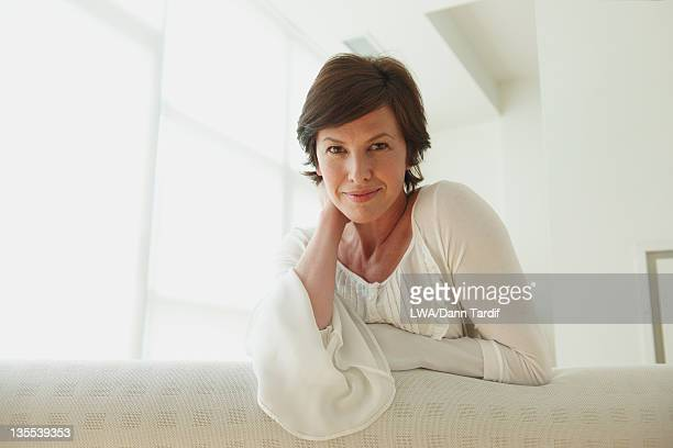 Caucasian woman leaning on sofa