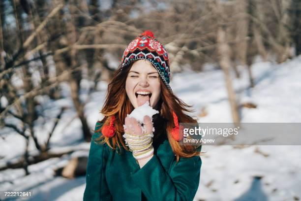 Caucasian woman licking snow