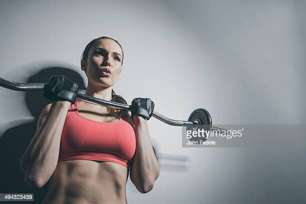 Caucasian woman lifting barbell