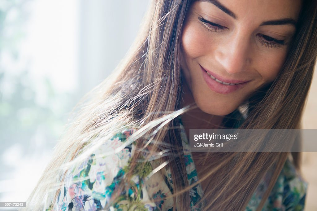 Caucasian woman looking down : Stock Photo