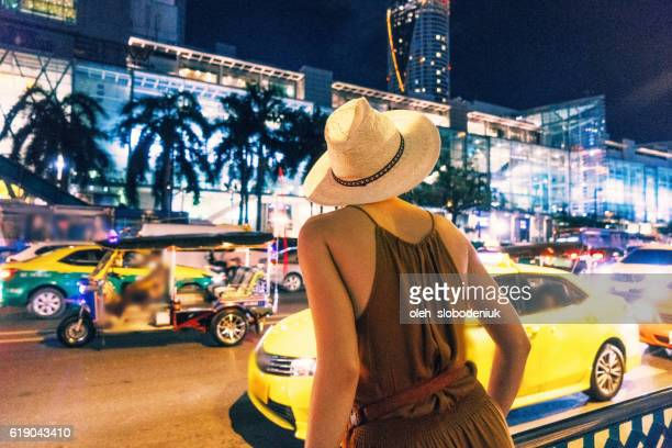 Caucasian woman looking for taxi in Bangkok