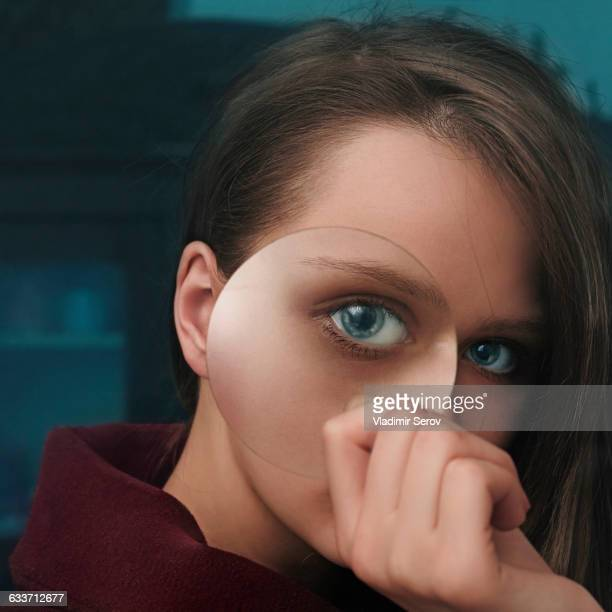 Caucasian woman looking through magnifying glass