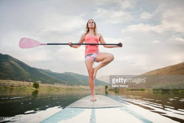 caucasian woman on stand up paddle board - image technique stock pictures, royalty-free photos & images