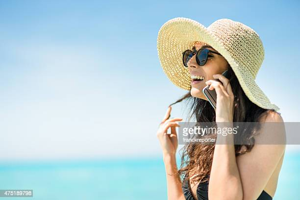 Caucasian woman on the phone at the caribbean