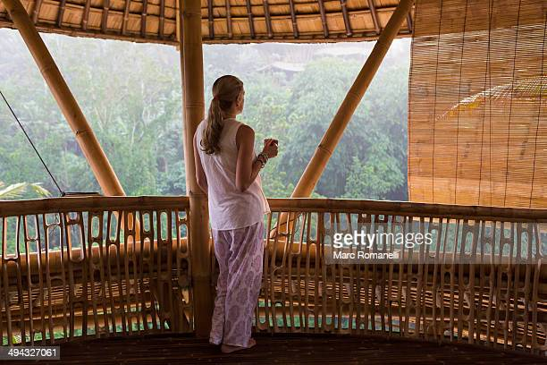 Caucasian woman overlooking view from balcony